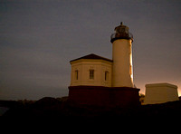 Coquille River Lighthouse by Lights at Night.